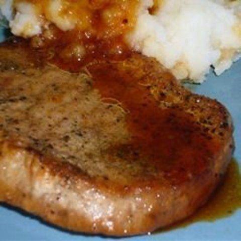 Bisteca de porco com molho de cidra de maçã
